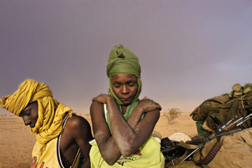 NORTH DARFUR.  Soldiers with the Sudanese Liberation Army wait by their truck while struck in the mud and hit by a sandsortm in North Darfur, Sudan, August 21, 2004.