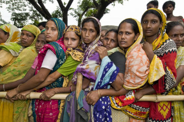 Bangladesh, Mimensingh, Women in the queue waiting for the recruitment for a job in the fields or in the place textures