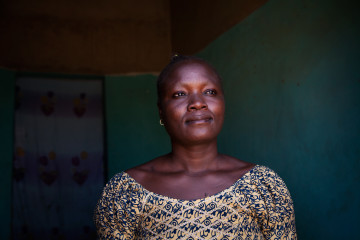 Awa Ouédraogo photographed by Leila Alaoui in Ouagadougou, Burkina Faso, on 13 January 2016, as part of the My Body My Rights campaign.  Awa Ouédraogo is fruit seller in Ouagadougou and a former resident of the Pan Bila shelter for survivors of forced marriage, rape and unwanted pregnancy in Ouagadougou. When she fell pregnant at age 14, she was rejected by her family, lived in the street and gave birth to her child one evening in a shop where she took refuge. Awa spent a few years at Pan Bila with her child and is now independent and able to provide for herself and her child thanks to her fruit stall.