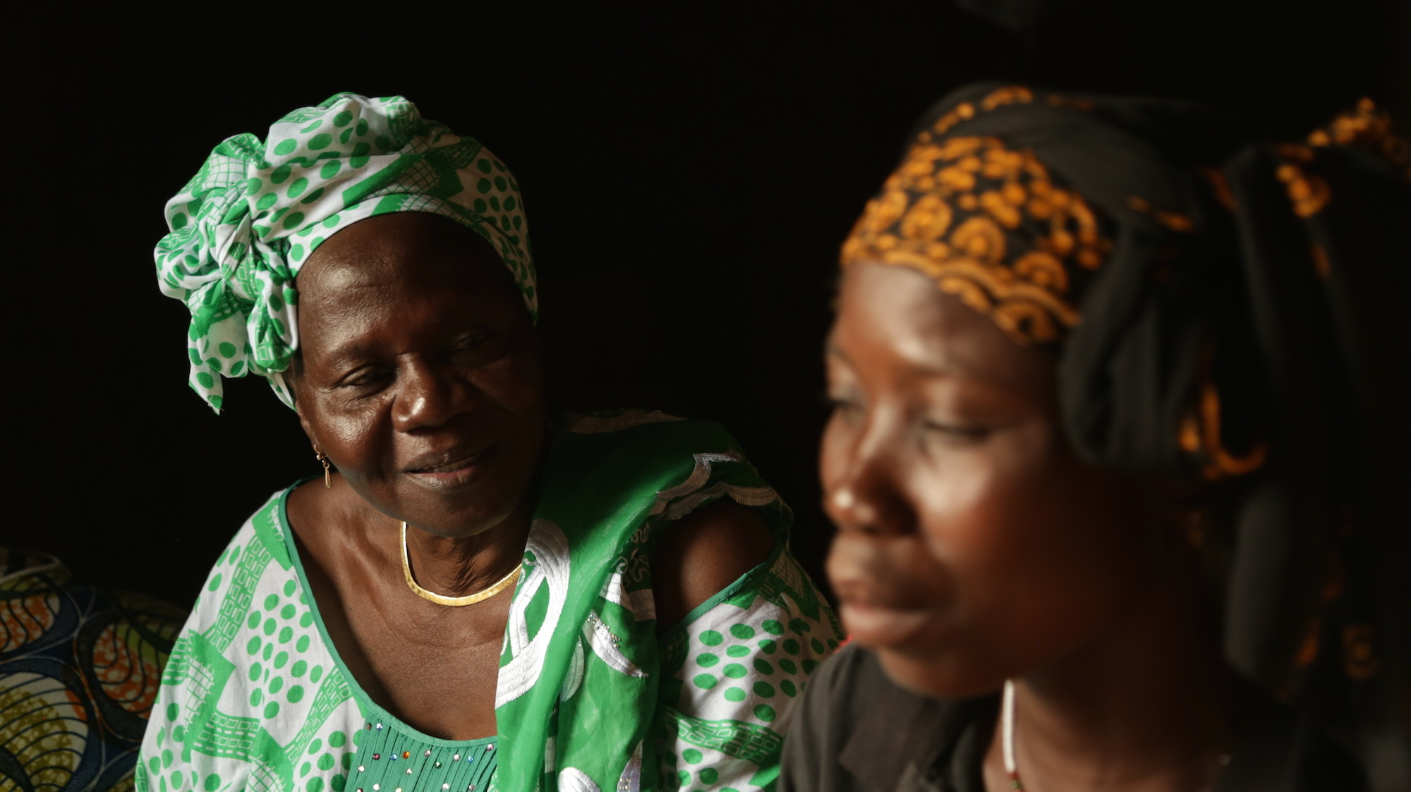 Women's rights activist Bibata Ouedraogo exchanges with Abibou Sanga during an individual counseling session on sexual and reproductive rights in the village of Sissaba, Burkina Faso. Because the themes she discusses sometimes discourage discourse in large groups, she takes the time to meet with individuals and small groups to address their specific issues. Photos were taken during the filming of a video featuring women's rights activist Bibata Ouedraogo in Ouahigouya, Burkina Faso, as part of Amnesty International?s My Body My Rights global campaign. The campaign will be launched in Burkina Faso on 15 July 2015. Bibata Ou?draogo is an activist committed to the promotion and protection of women?s rights, including sexual rights and reproductive rights and the right to maternal health. Her work focuses on community outreach on HIV/AIDS, maternal health, violence and discrimination against women, FGM, forced marriage, early. Bibata Ou?draogo is the president of the Ouahigouya branch of AFEDEB, a women's association for the development of Burkina Faso. Ouahigouya is a town approximately 180 km from the capital Ouagadougou. The association covers 15 sectors surrounding Ouahigouya and nine of the 36 villages of Ouahigouya. Bibata Ou?draogo is a former teacher. She is married and mother of six children. Her passion for human rights has led her to continue working despite her retirement from teaching in 2013.