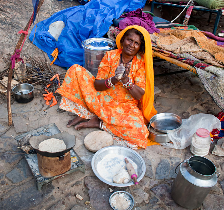 Jaipur, india-sept 26 : indian woman preparing a meal on the street, on the way to surya mandir or temple of the sun god, september 26, 2013 in jaipur, rajasthan, india. Photo Credit: Olena Tur
